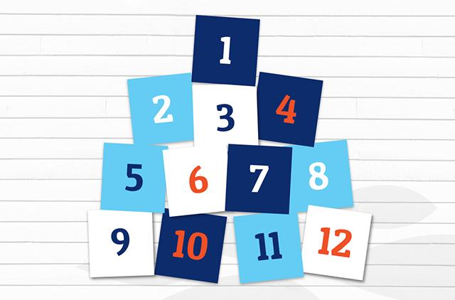 12 numbered blocks piled together