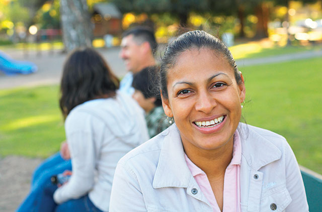 woman smiling in park Identity-Theft-Protection
