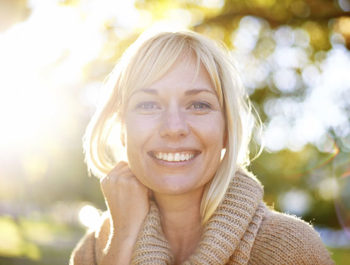 Smiling blonde woman outside
