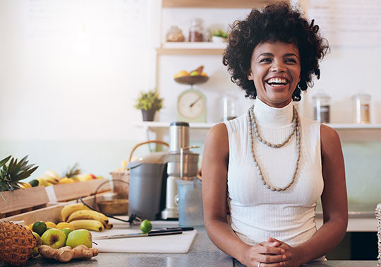 happy woman at counter SBA-Loans