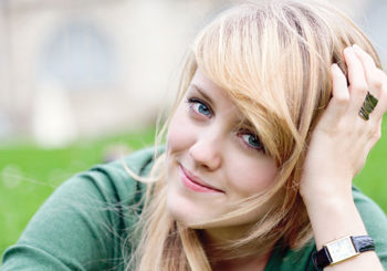 pretty blonde girl smiling Scholarship-Application