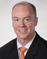smiling man wearing tie Scott Higgins