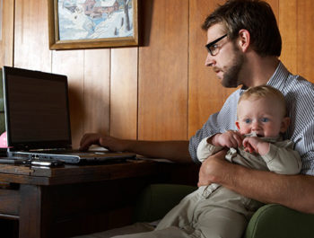 Dad with baby on computer