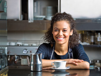 smiling woman with coffee or tea
