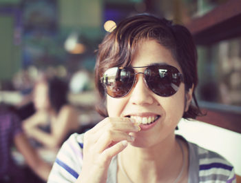 smiling dark haired woman in sunglasses