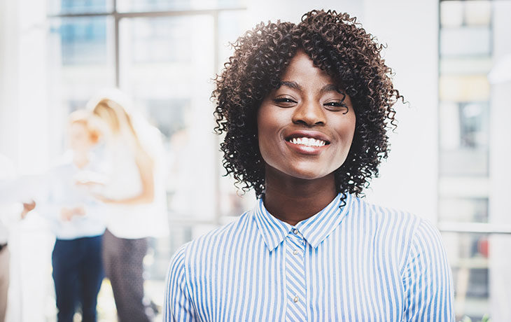 smiling woman in button up