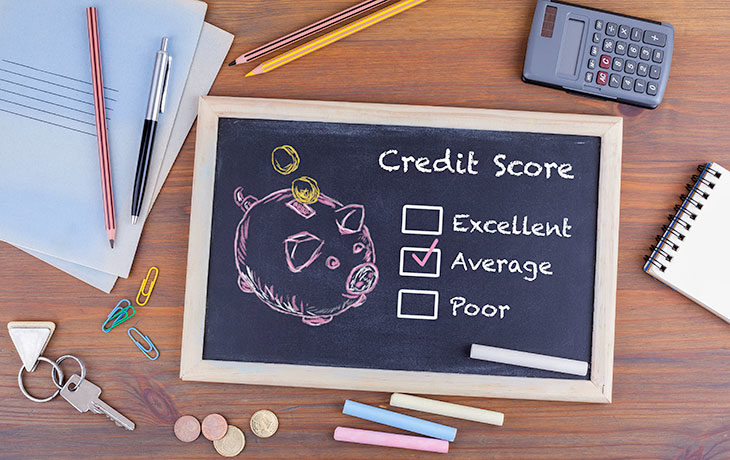 chalkboard and chalk with credit score info