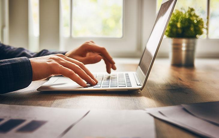 close up of hands at a keyboard