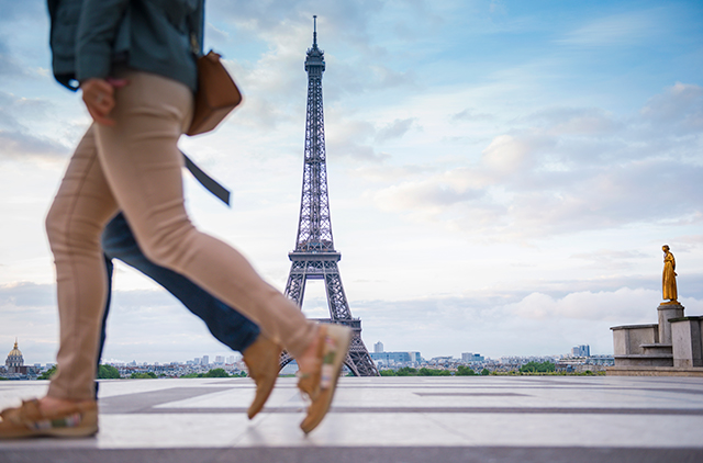 two people walking in front of Eiffel Tower