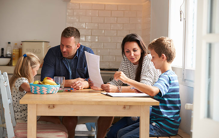 family with children gathered around table Home-Equity-Loan-or-Line-of-Credit