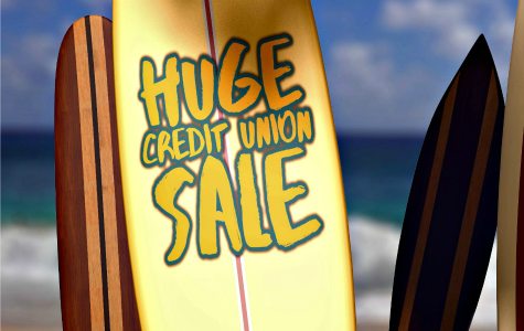 "Upright surfboard on a beach that says ""Huge Credit Union Sale"""
