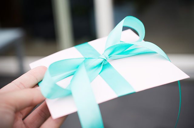 Envelope with ribbon tied around it