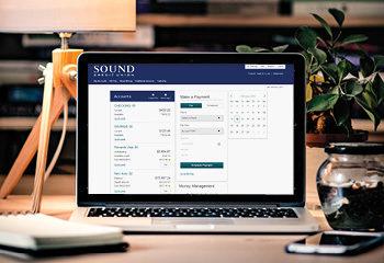 computer showing online banking on desk