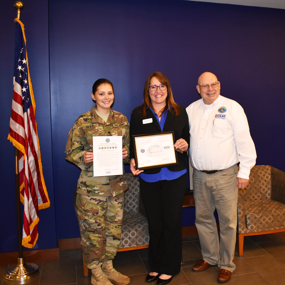 Spc. Shannon Seipp and Branch Manager Wendi Plain receiving the Patriot Award from ESGR Area Chair Wayne Hilton