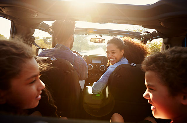 Family riding in Jeep