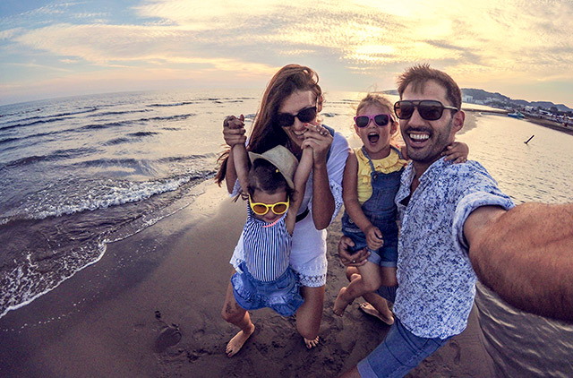 Playful Family selfie with wide angle camera stock photo