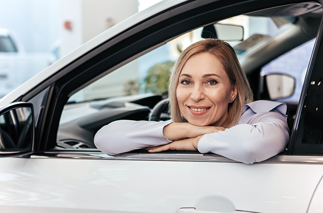Woman shopping for a leased car.