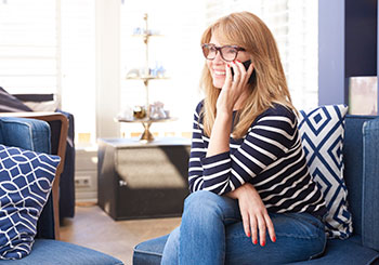 Woman talking on the phone in her living room