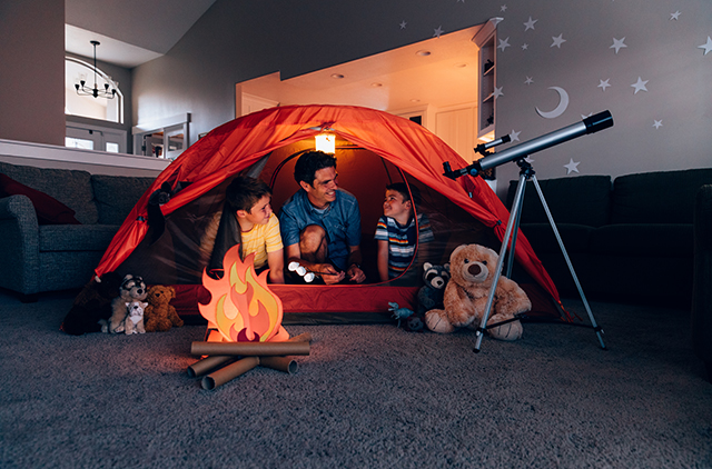Father and Sons Camping Indoors