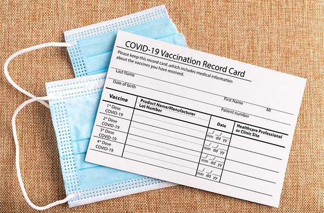 Coronavirus vaccination record card. Protective mask divided into two parts.