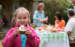 Child eating cake at outdoor party
