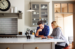 Couple meeting on finances in kitchen