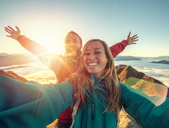 Friends hiking above the clouds selfie