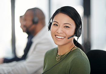 Contact Center Agent with headset smiling