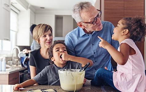 Grandparents baking cookies with grandkids