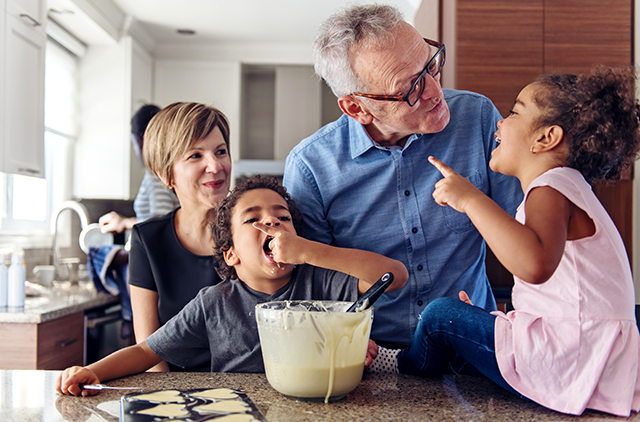 Grandparents baking cookies with grandkids
