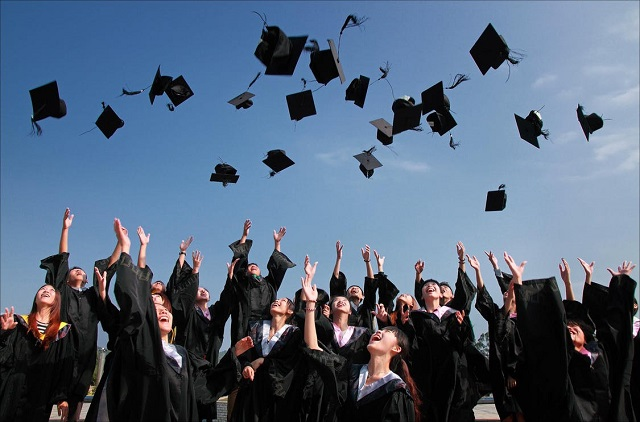 Students Throwin Graduation Caps in the Air