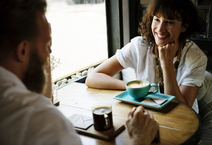 coffee, two people interviewing, sitting at a table