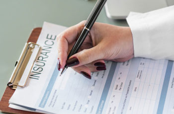 person completing insurance paperwork